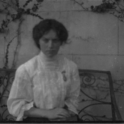 8D Kathleen on seat at hall door, 20 Oct 1913.jpg
